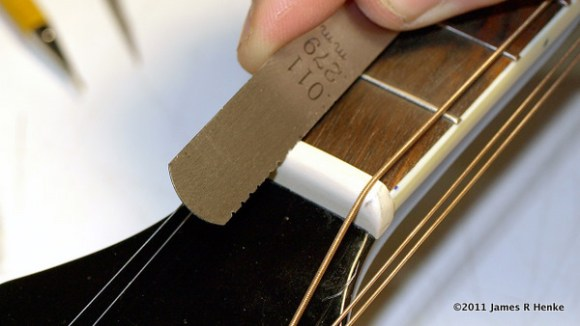 Cutting nut slots for the 4 courses of double strings.