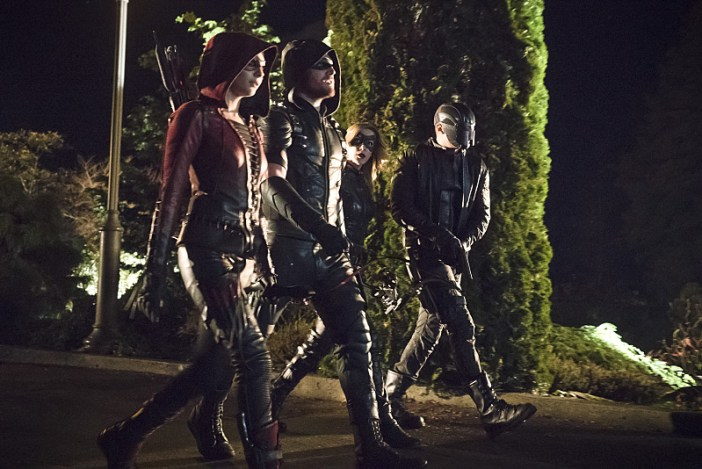 "Arrow -- ""Blood Debts"" -- Image AR410a_0114b.jpg -- Pictured (L-R): Willa Holland as Speedy, Stephen Amell as The Arrow, Katie Cassidy as Black Canary and David Ramsey as John Diggle -- Photo: Katie Yu/ The CW -- © 2015 The CW Network, LLC. All Rights Reserved."