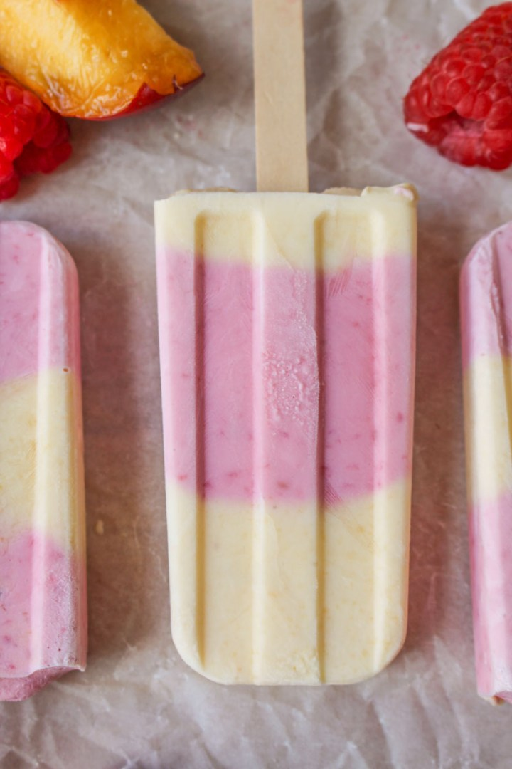 Peach Raspberry Ice Lollies, made with fresh fruit, Greek yogurt, and honey | What Charlotte Baked