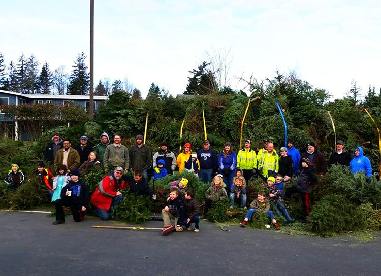 Ferndale Cub Scouts pose with over 400 Christmas trees collected during the 2017 tree pickup (January 7, 2017). Photo courtesy Cub Scout Pack 4026
