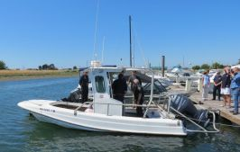 officials check out the boston whaler donated by p66 to wcfd17