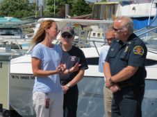 p66 refinery manager julia presents wcfd17 fire chief with keys to donated boston whaler ship