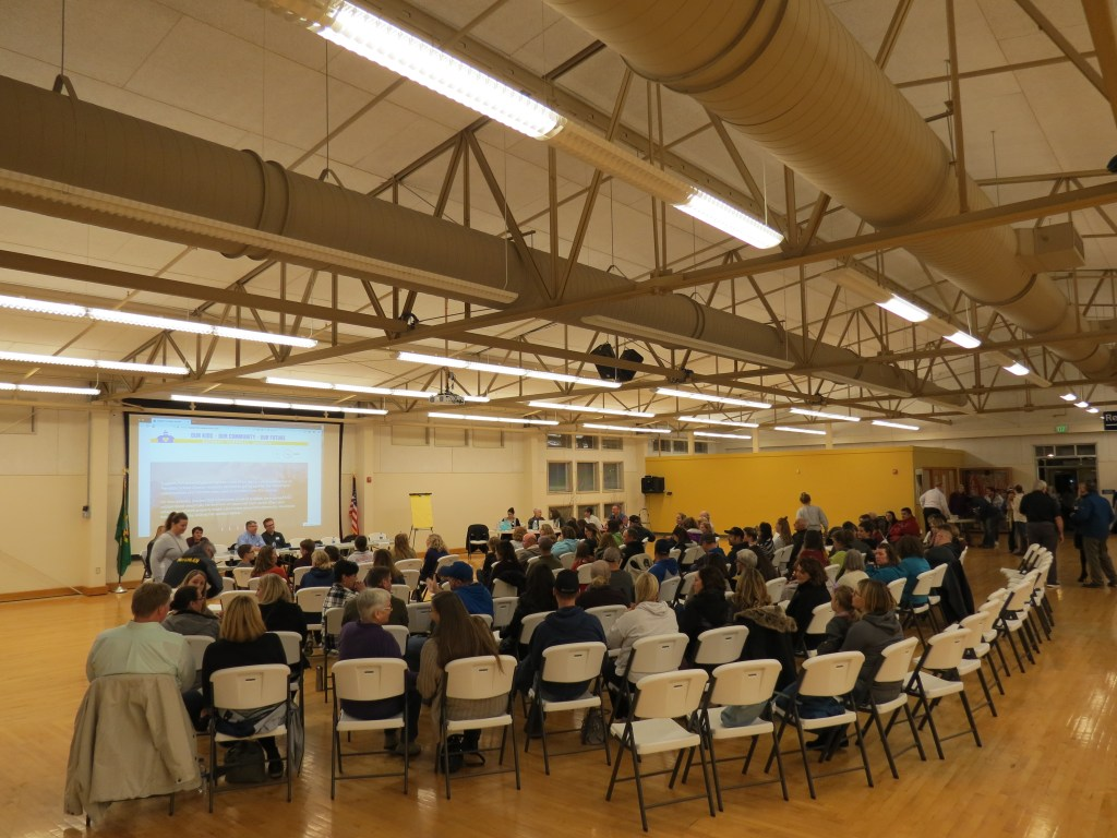 panel members and attendees take their seats just prior to a school bond town hall meeting 2018-11-15