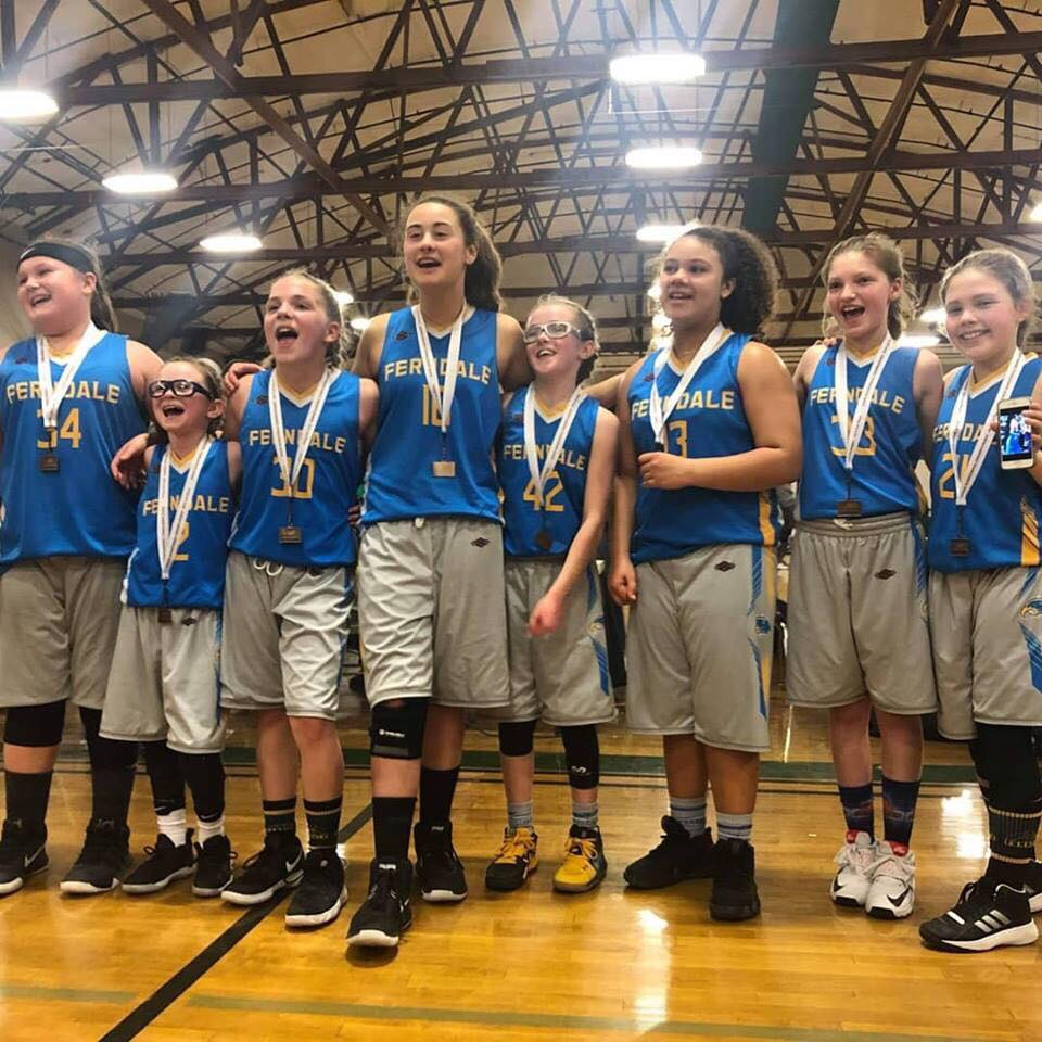 Ferndale Girls Basketball Association 5th grade girls team pose together after winning 3rd place at the state tournament at Warehouse Athletic Facility in Spokane (March 17, 2019). Photo credit: Mandy Mills