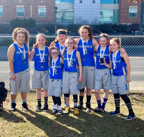 Ferndale Girls Basketball Association 5th grade girls team pose together after winning 3rd place at the state tournament outside the Warehouse Athletic Facility in Spokane (March 17, 2019). Photo credit: Mandy Mills