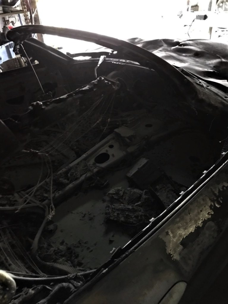 Interior of a car after a fire in an out building on Neevel Road after a fire (October 12, 2019). Photo courtesy of WCFD7.
