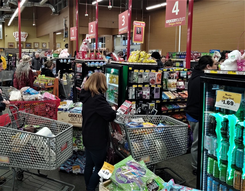 Shoppers wait to check out at Ferndale Grocery Outlet (March 13, 2020). Photo: Whatcom News