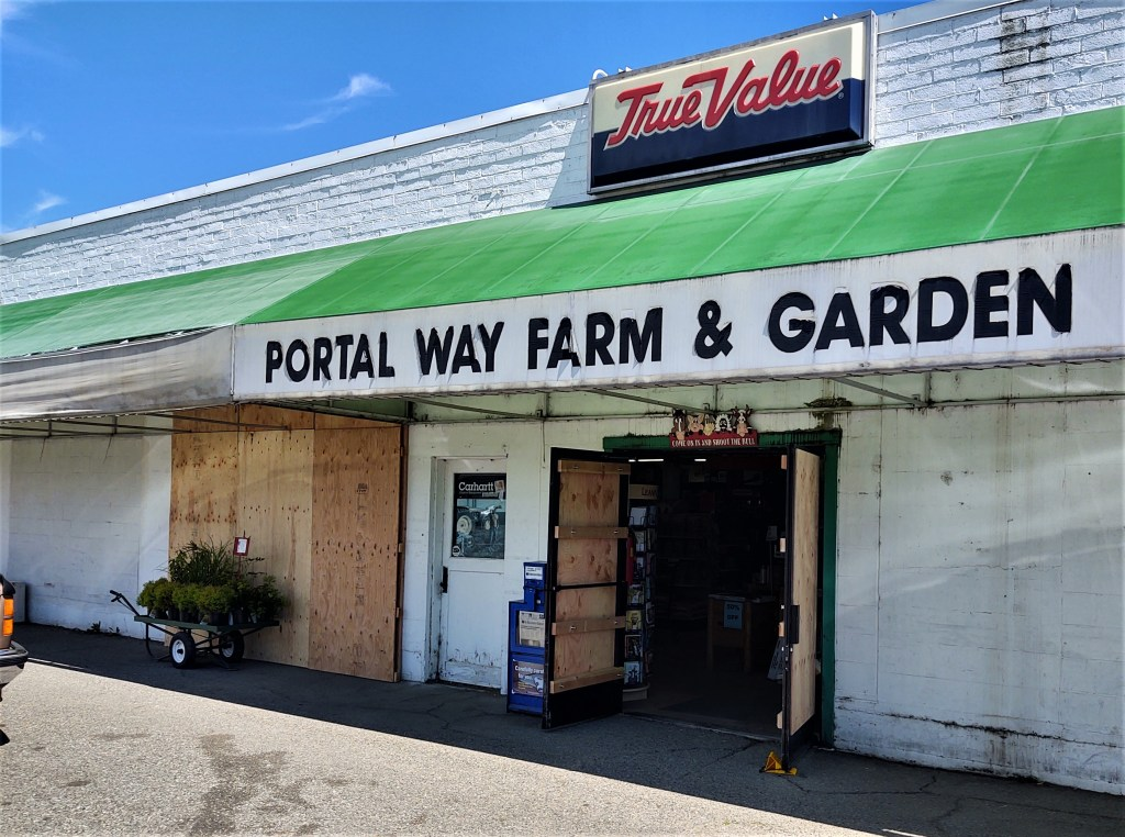 Portal Way Farm and Garden doors and windows with plywood repairs after front doors and a window were shattered (July 28, 2020). Photo: My Ferndale News