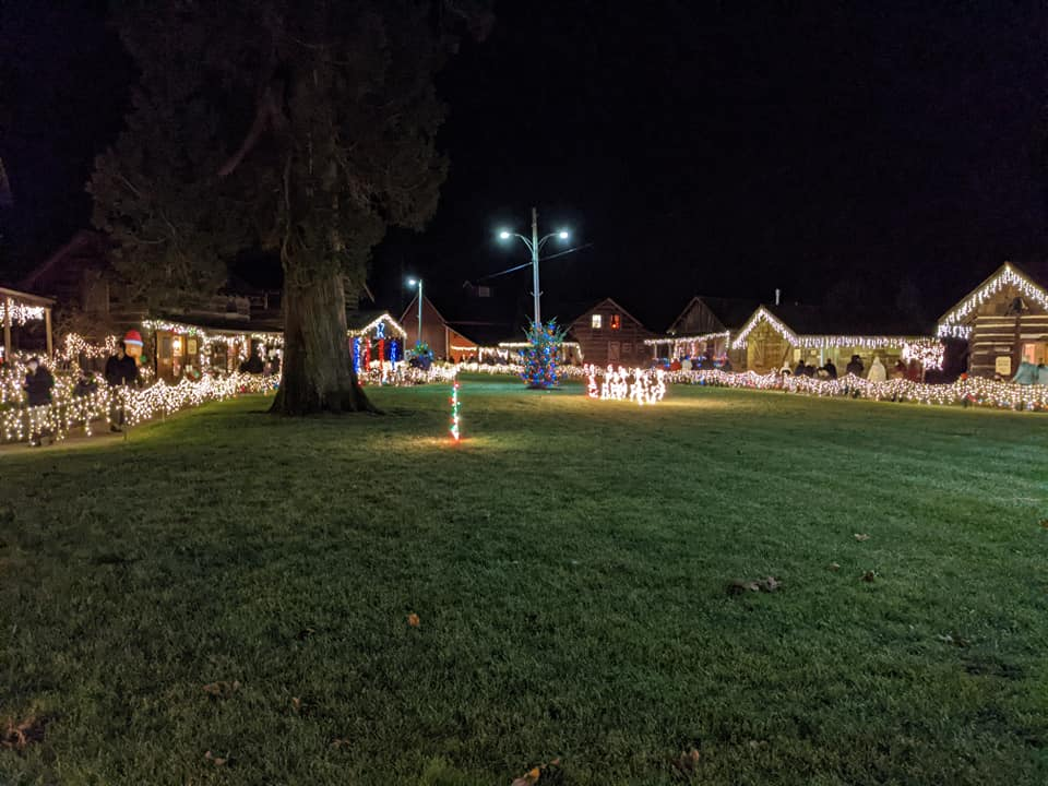 Pioneer Park cabins decorated during the Lighted Christmas Stroll event (December 2020). Photo: Kari Olson