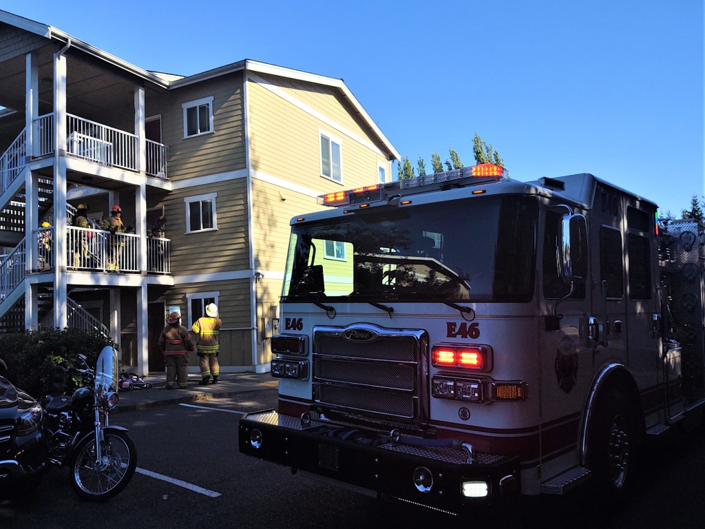 WCFD7 firefighters at the scene of an apartment fire (May 9, 2021). Photo: Whatcom News
