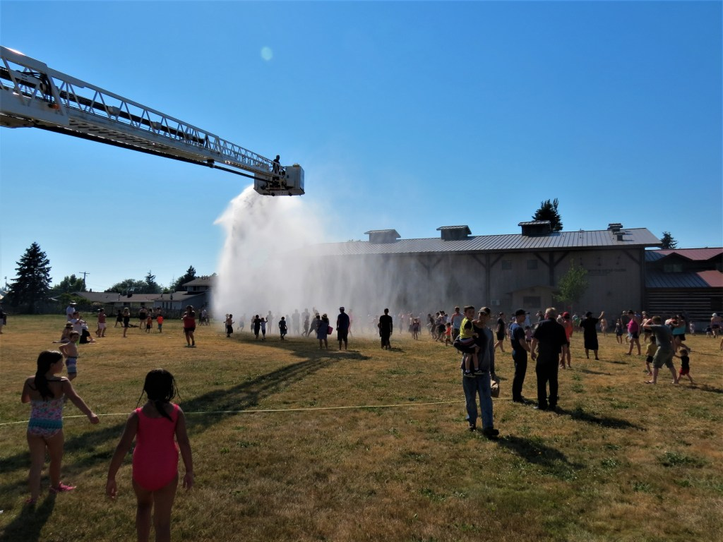 Whatcom County Fire District 7 crews provide a fun way to cool down at Pioneer Park in Ferndale during a heat wave (June 28, 2021). Photo: Whatcom News