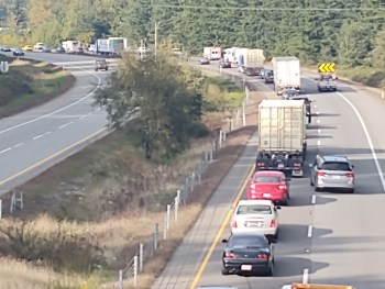 Scene of a semi truck and trailer rollover on I-5 south of Grandview Road (October 7, 2021). Photo: Whatcom News