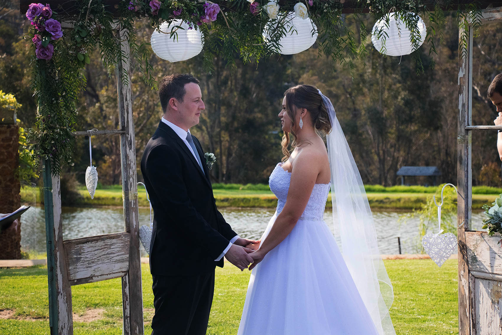 Bride and groom hold hands at Clover Cottage Retreat, Manjimup