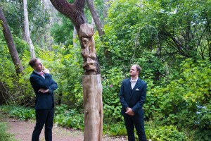 Groom and groomsman admiring a piece of garden art at Holberry House in Nannup