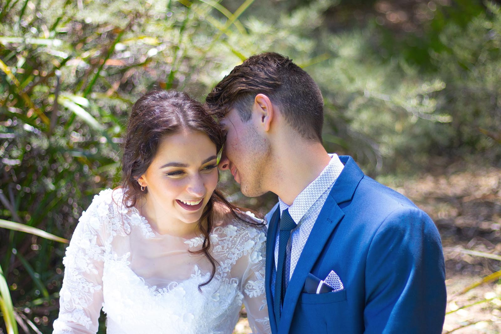 Groom whispers into his bride's ear