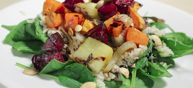 This fall salad incorporates roasted root vegetables, squash seeds, brown rice, spinach and a balsamic reduction. Feel free to mix and match with what's on hand!