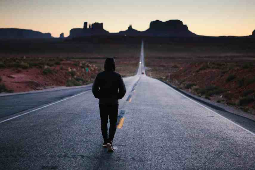 man walking down the road looking for motivation and self-discipline