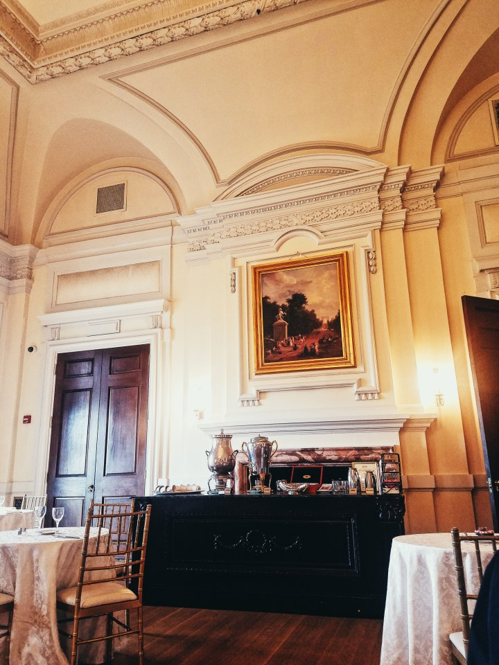 Tea station in grand ballroom with giant painting above at Oheka Castle on Long Island