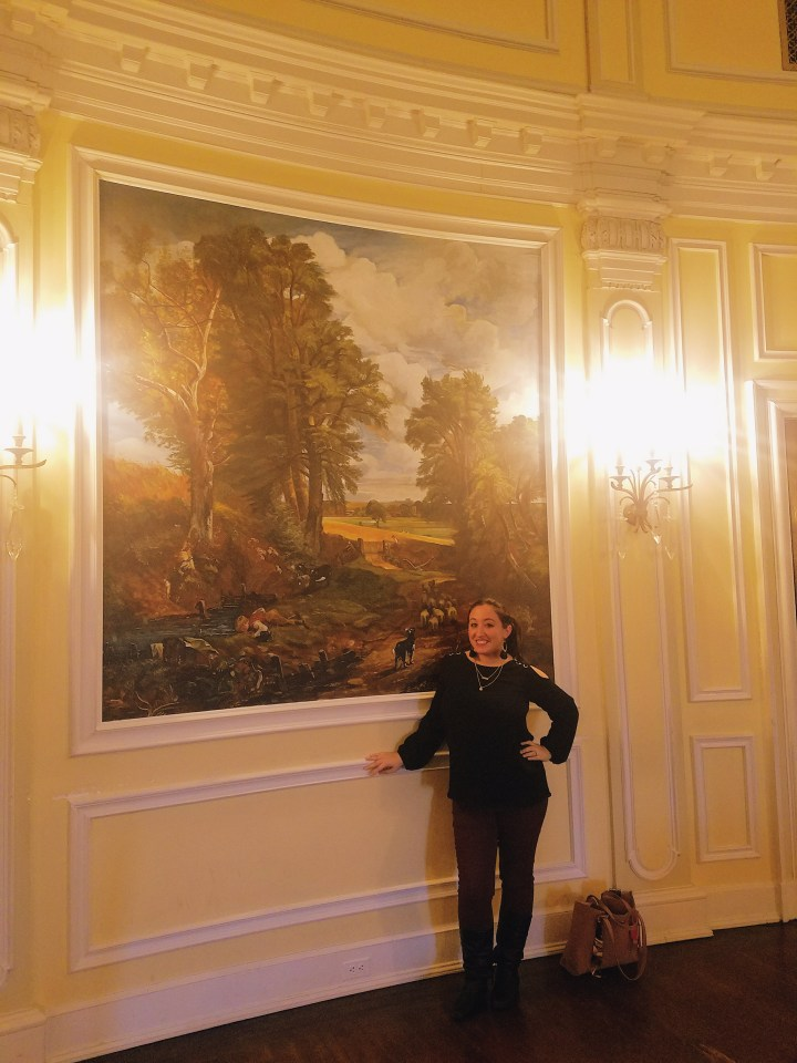 standing by giant mural in Oheka Castle on Long Island
