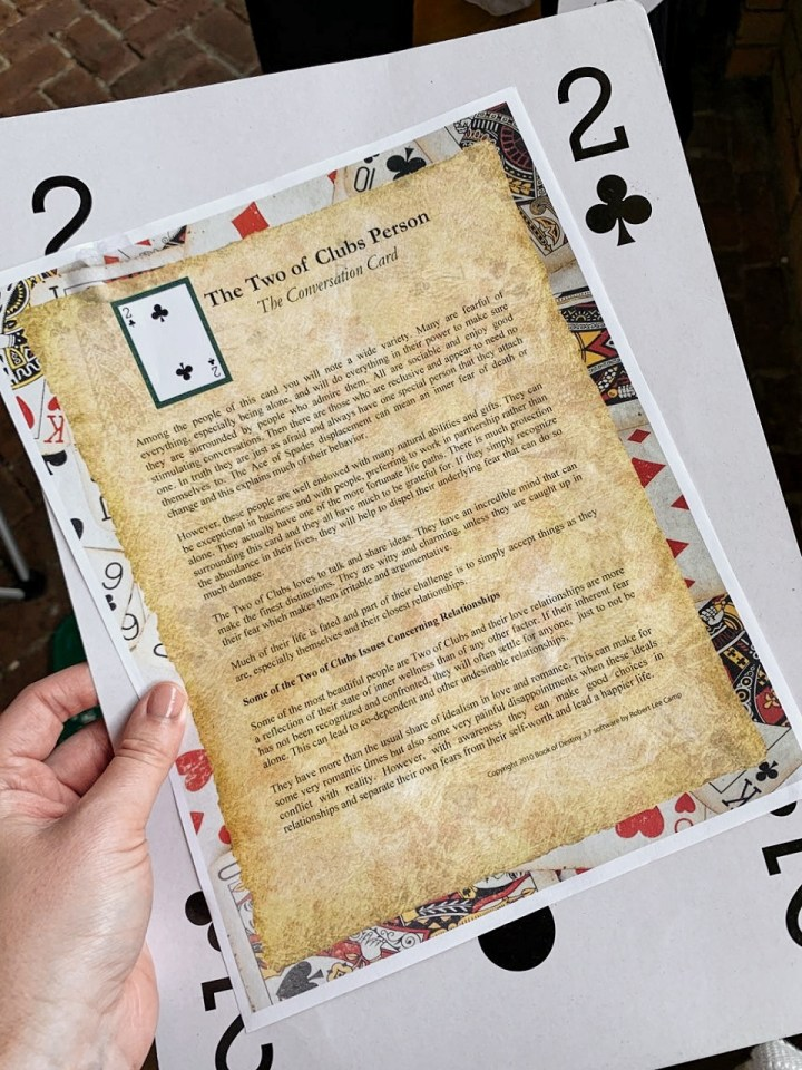"A giant 2 of clubs playing card. A description of what a ""two of clubs"" person tensds to be like."