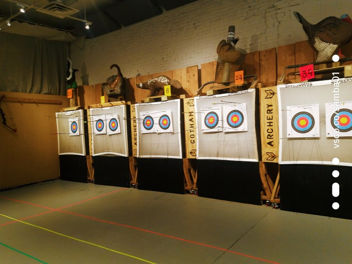 A series of archery targets are lined up for practice at Gotham Archery.