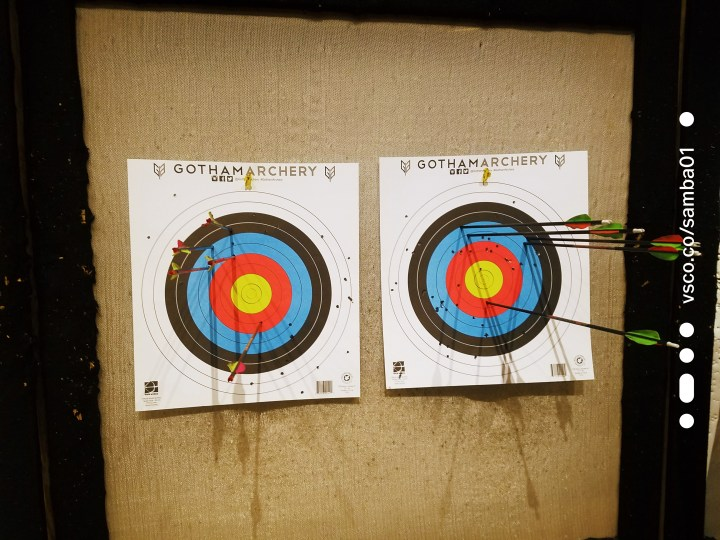 two archery targets with bows inside of the targets at Gotham Archery
