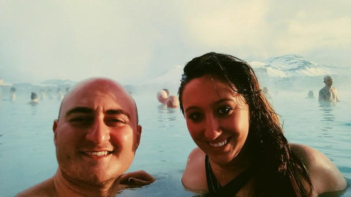 A man and woman take a selfie in the Blue Lagoon