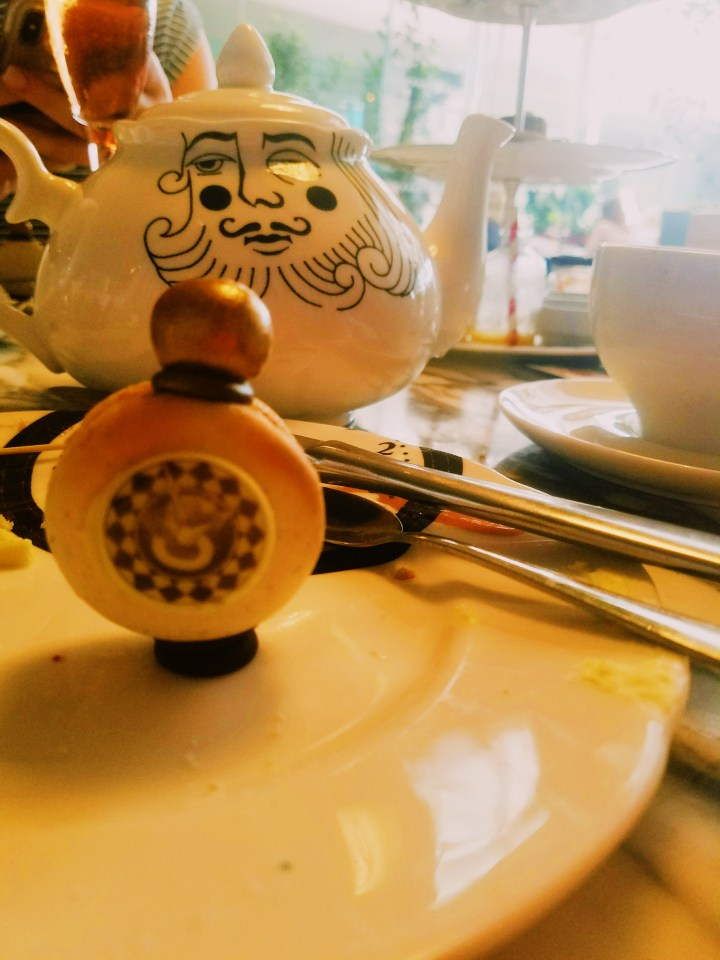 Pocket watch vanilla macaron served at the Sanderson hotel Mad Hatter's afternoon tea in London