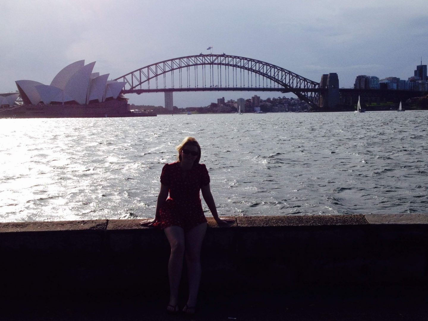 Laura in front of Sydney Harbour Bridge and Sydney Opera House