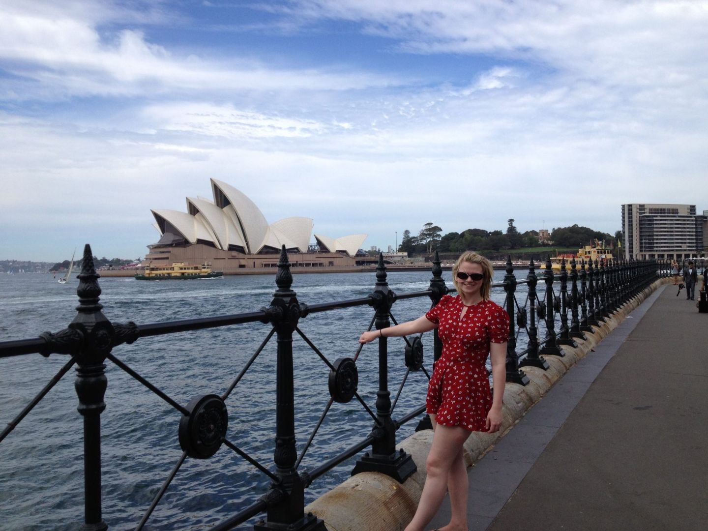 Laura hanging off the rails in front of Sydney Opera House in Circular Quay