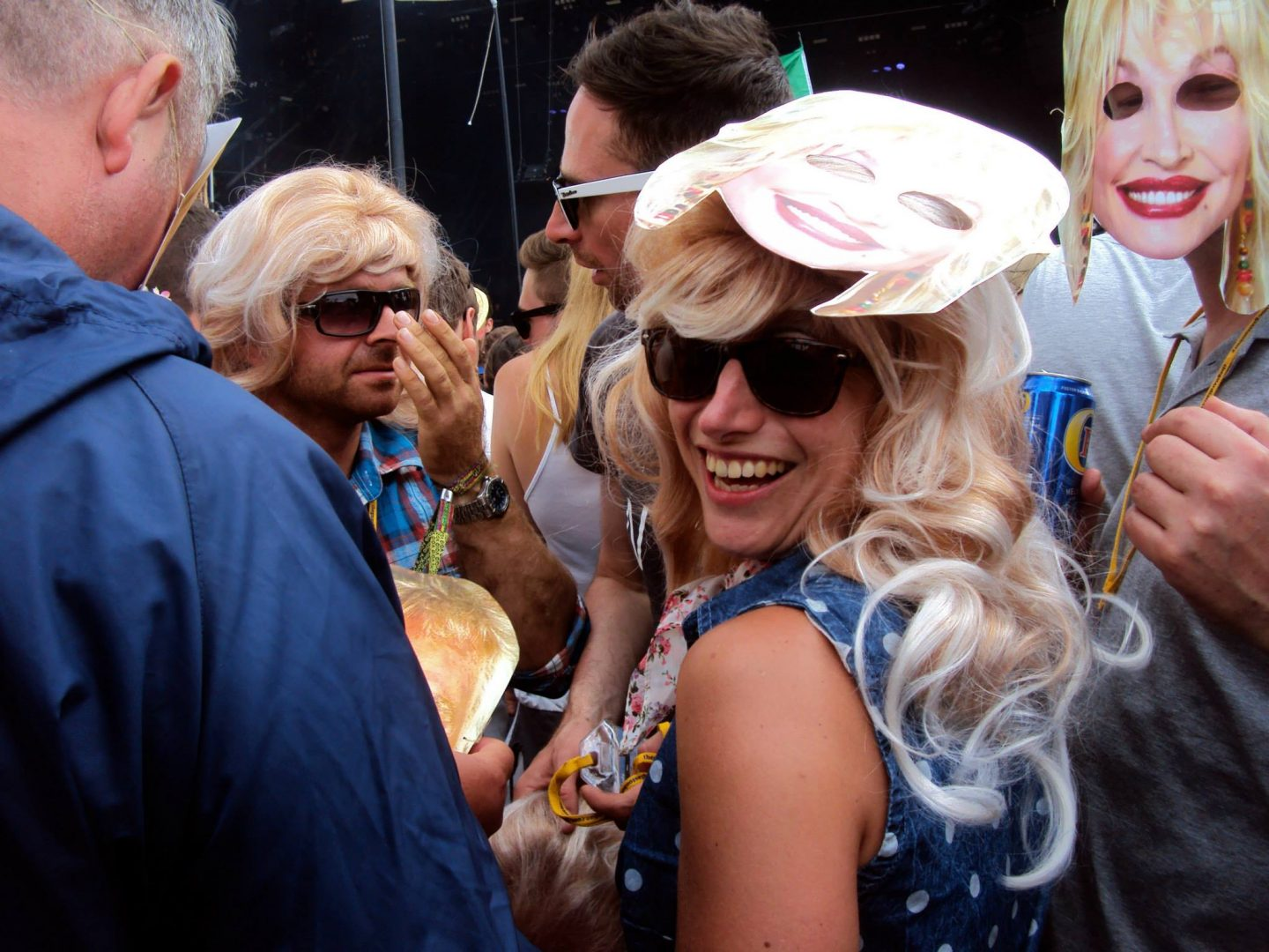 Crowd dressed as Dolly Parton
