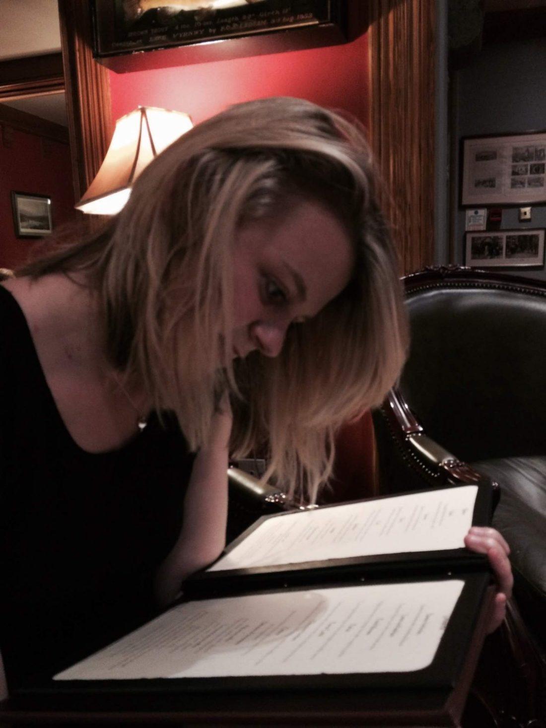 Laura looking at the menu