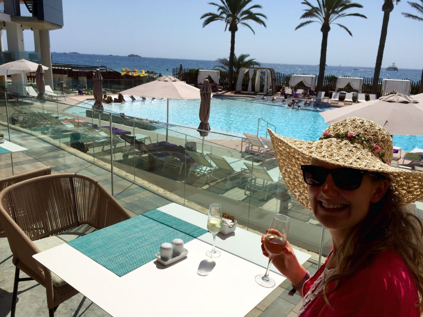 Jo drinking by the pool in Ibiza