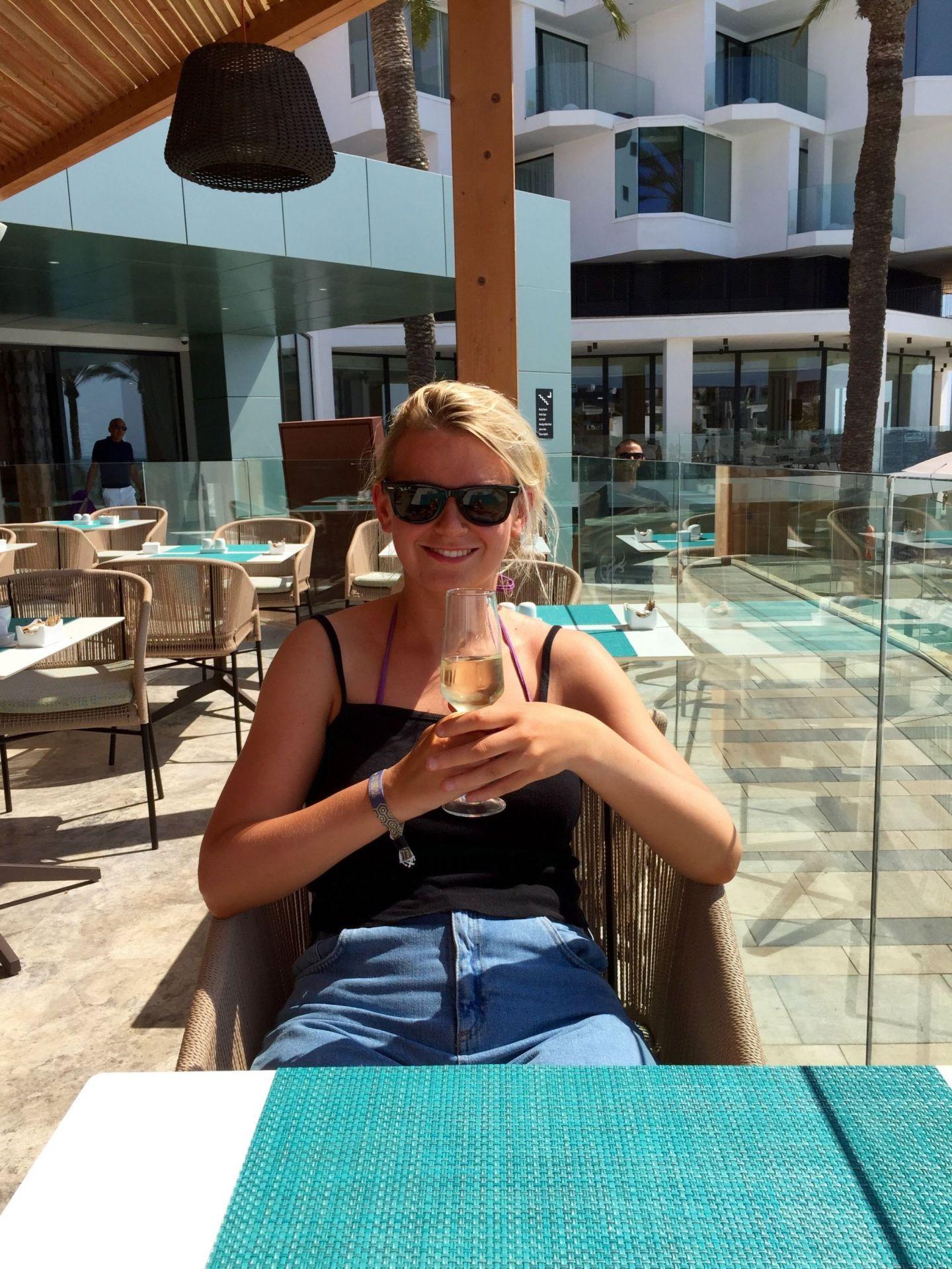 Laura enjoying champagne
