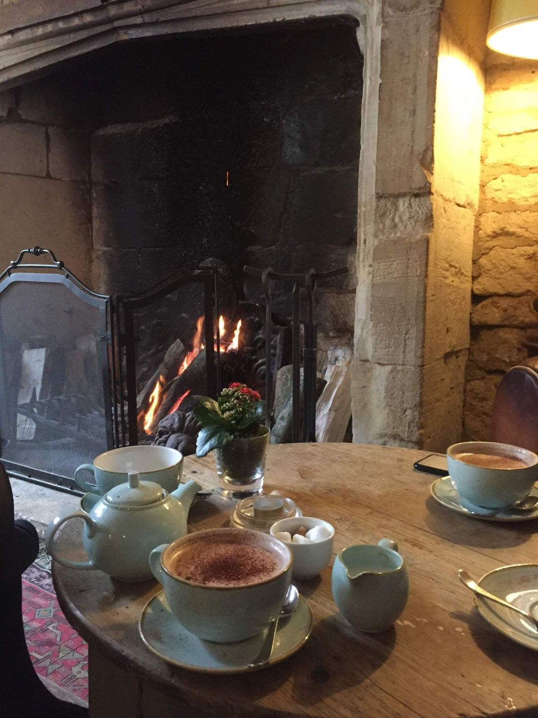 Drinks by the fireplace at The Lion, Winchcombe