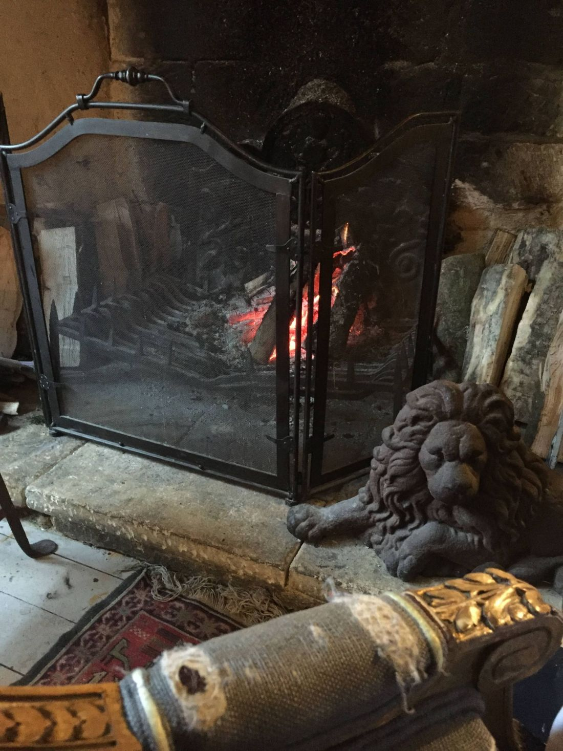 An open fire at The Lion Inn, Cheltenham