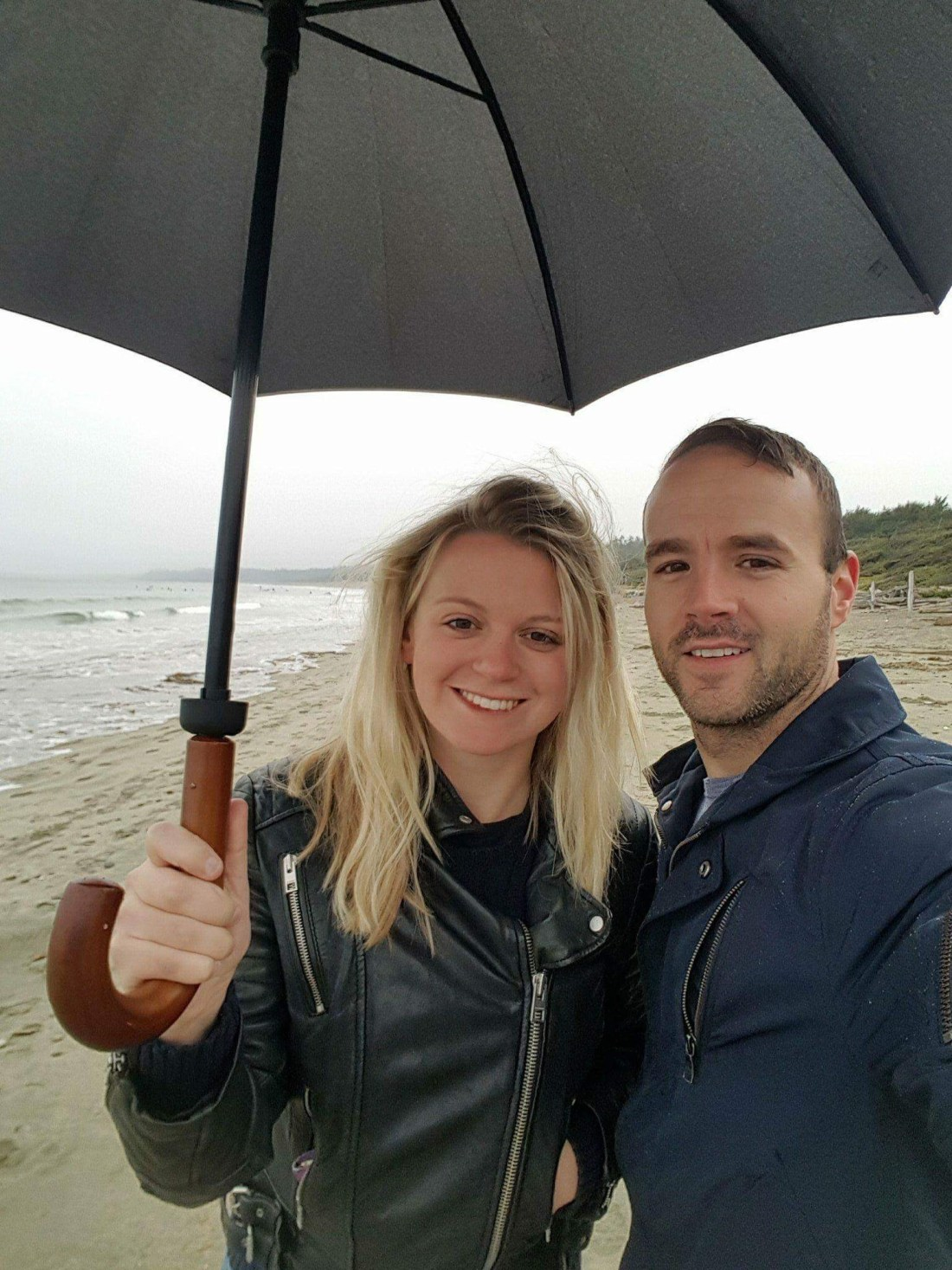 Couple with an umbrella in Pacific Rim National Park