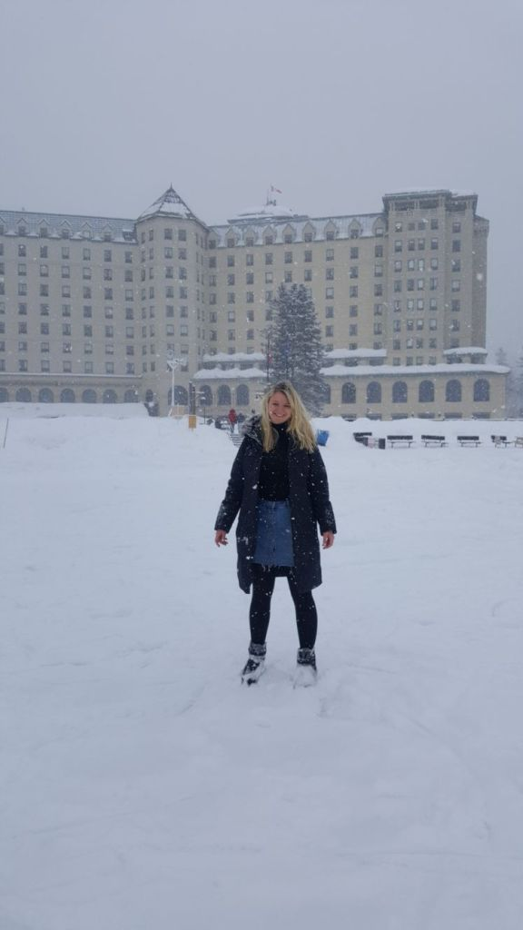 Standing on the ice rink outside Fairmont Chateau Lake Louise