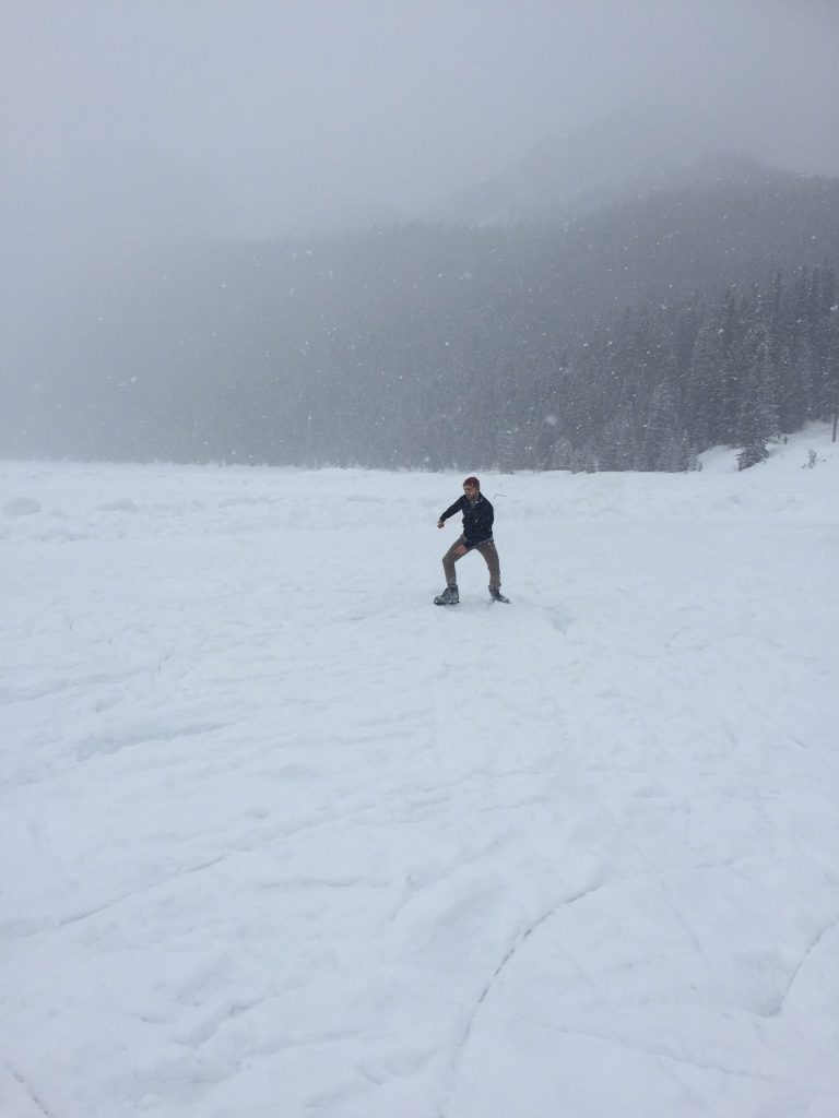 Ice skating tricks across Lake Louise