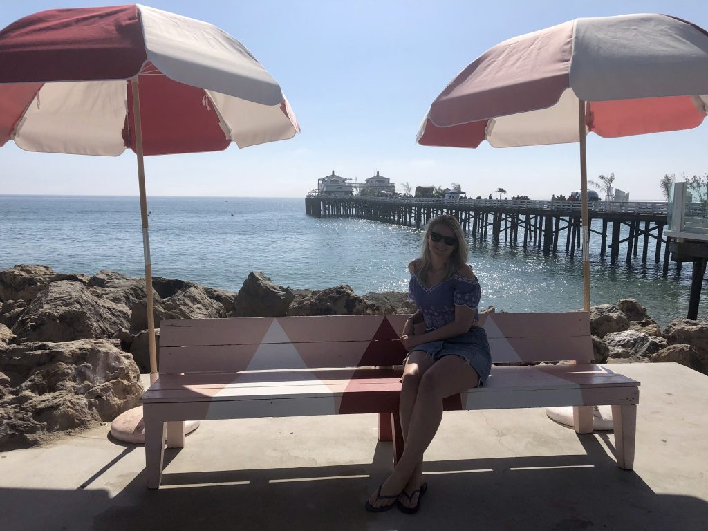Sat under parasols in Malibu, overlooking Malibu Pier