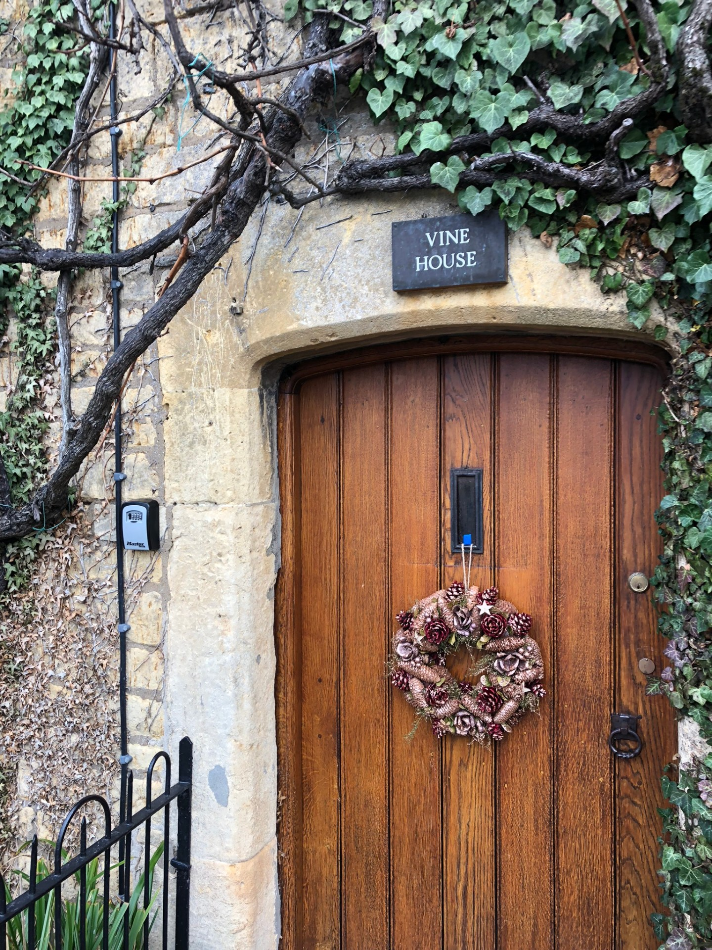 A Christmas wreath on a door in the Cotswolds