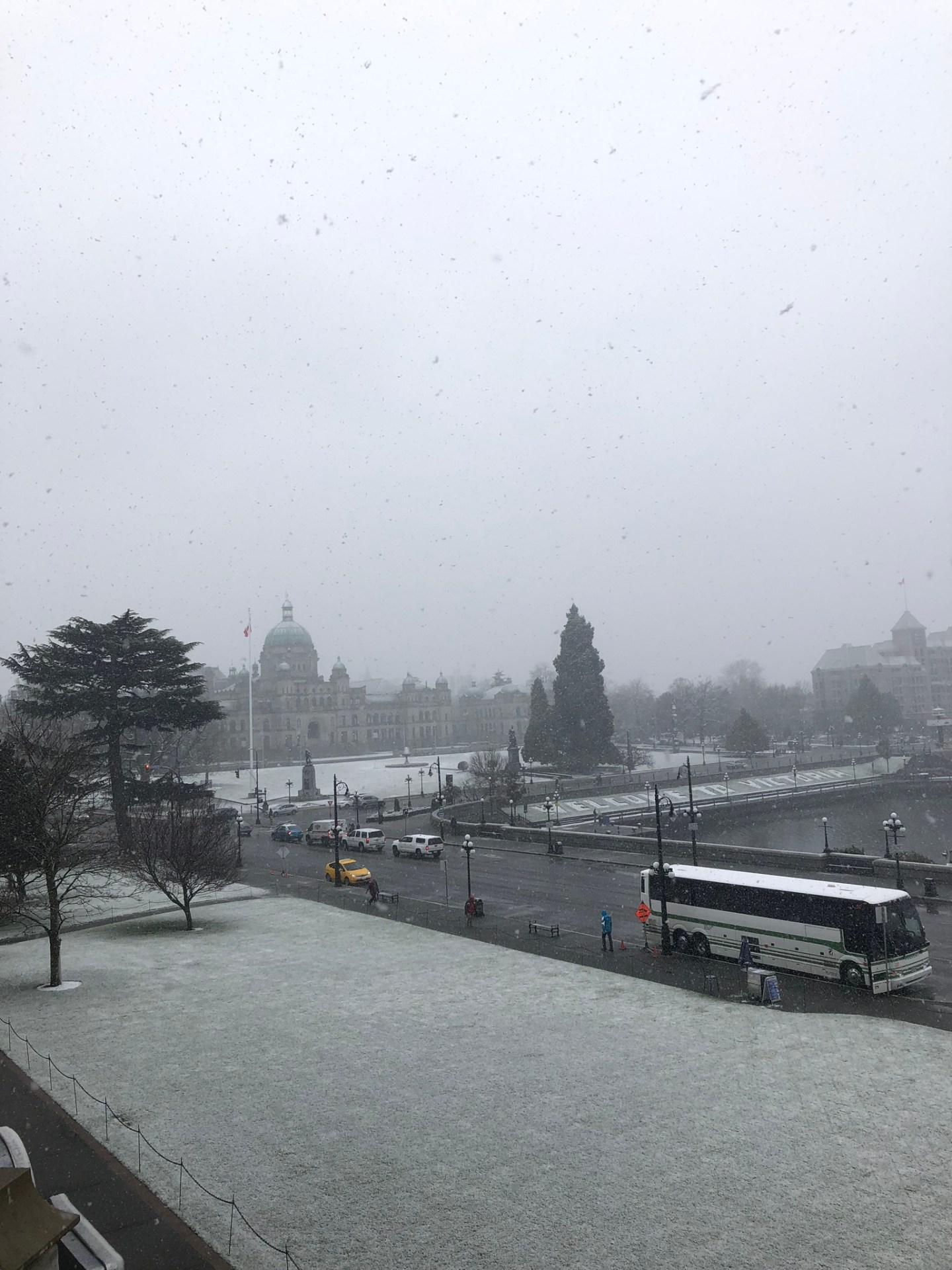 Snow falling over Victoria, British Columbia and the Parliament Building