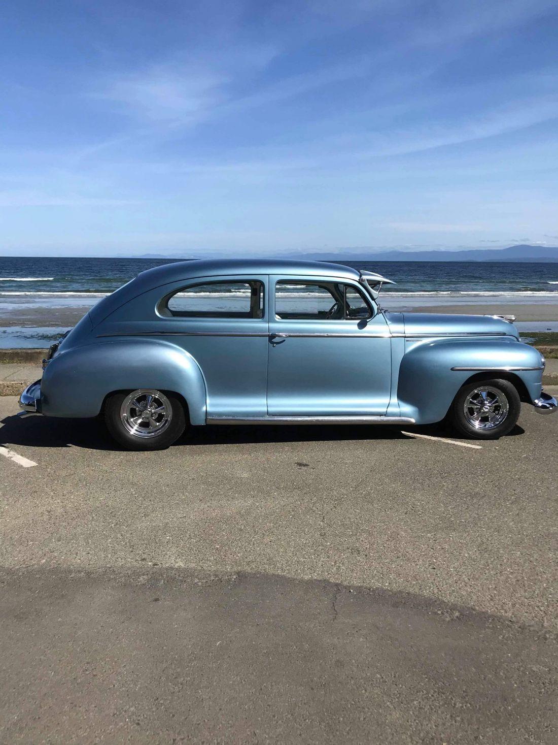 Vintage car at Qualicum Beach, Vancouver Island