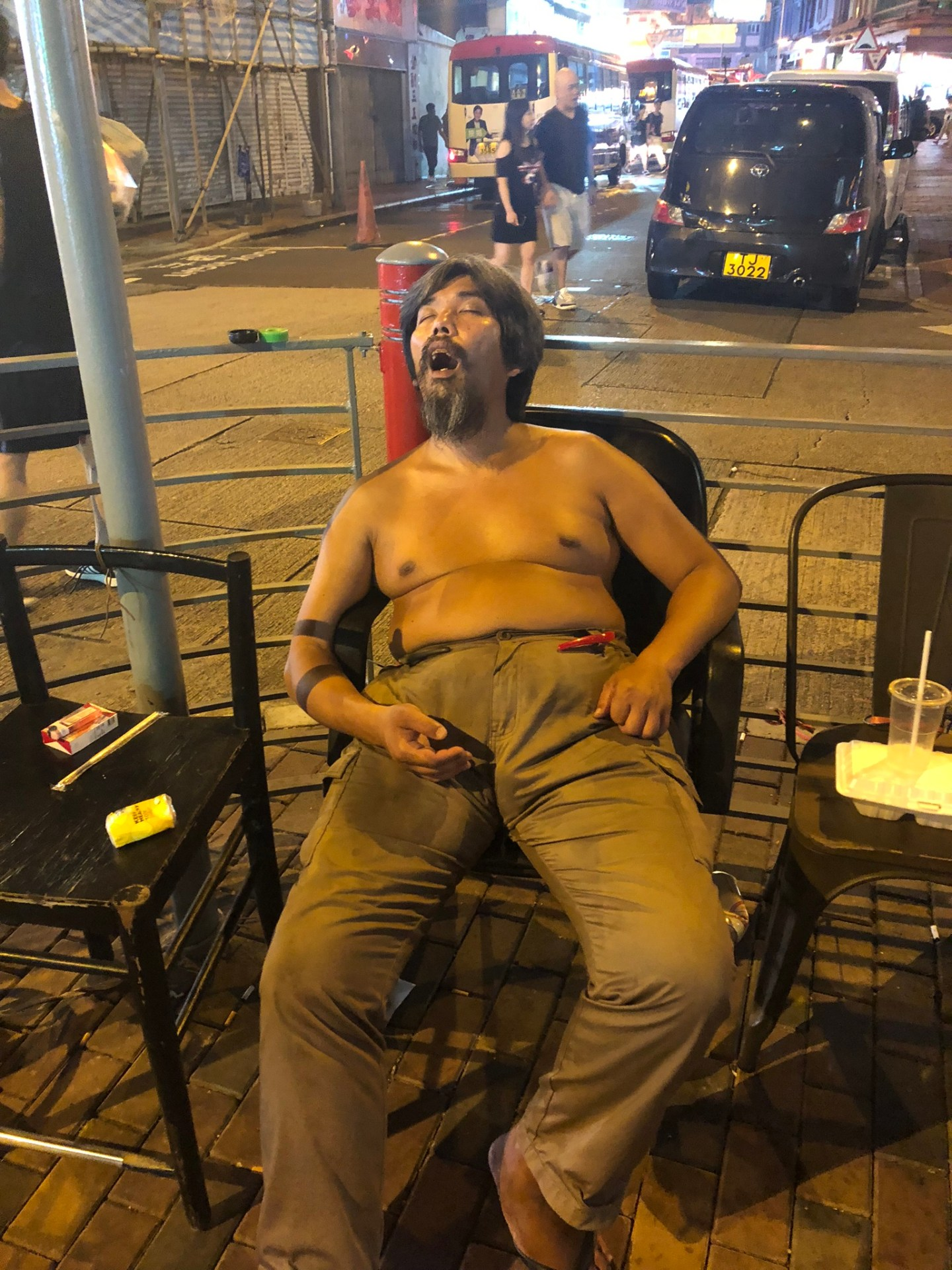 Man asleep in Hong Kong
