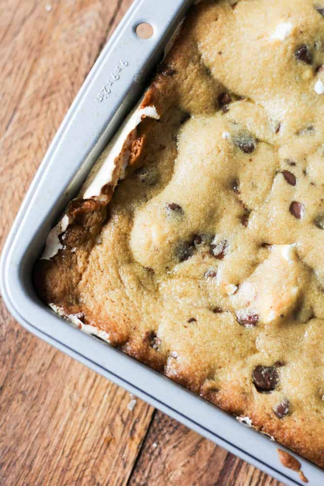 What do you get when you put chocolate peanut butter chips, marshmallow fluff and graham crackers between two cookies? Death by delicious. And also chocolate chip cookie s'mores bars.
