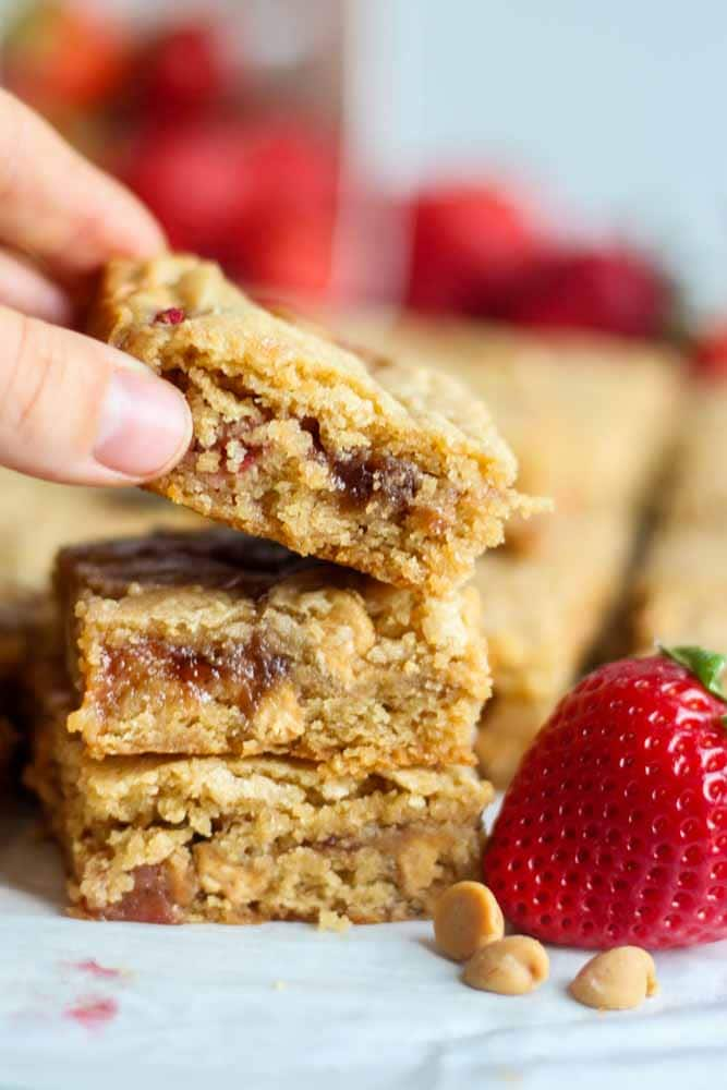 The classic blondie turned peanut butter and jelly just in time for school to start! These peanut butter and jam filled blondies are soft, chewy and a perfectly sweet back-to-school dessert or snack.