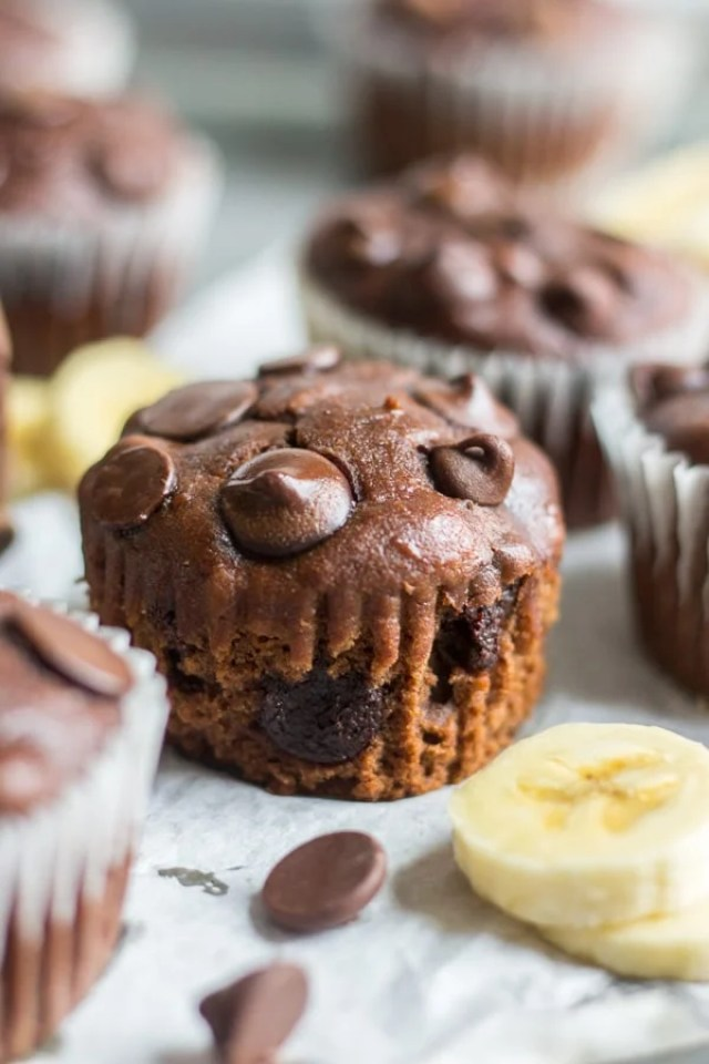 Healthy chocolate banana blender muffins! This muffin recipe is easy to make and gluten free. Mix the dry ingredients then blend all of the wet ingredients together. Fold in chocolate chips and bake until melted and gooey. They're also made with coconut oil and greek yogurt. They're the perfect magical chocolate muffin and so guilt free.
