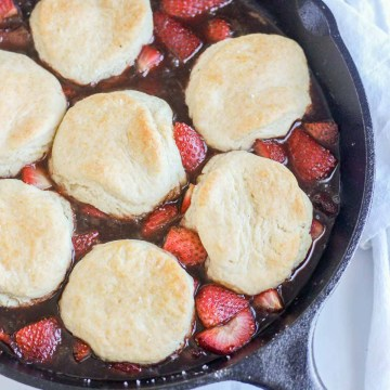 This roasted strawberry cobbler is the perfect healthy summer dessert. It's fresh and sweet and so easy to make. Not to mention it's vegan and refined sugar free.