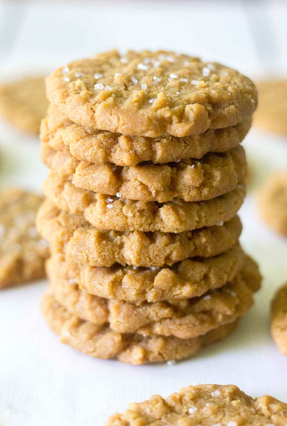 These flourless peanut butter cookies are made in less than 20 minutes! They don't include any flour so they're gluten free, plus there's no butter in this recipe either. You will love how delicious they are!