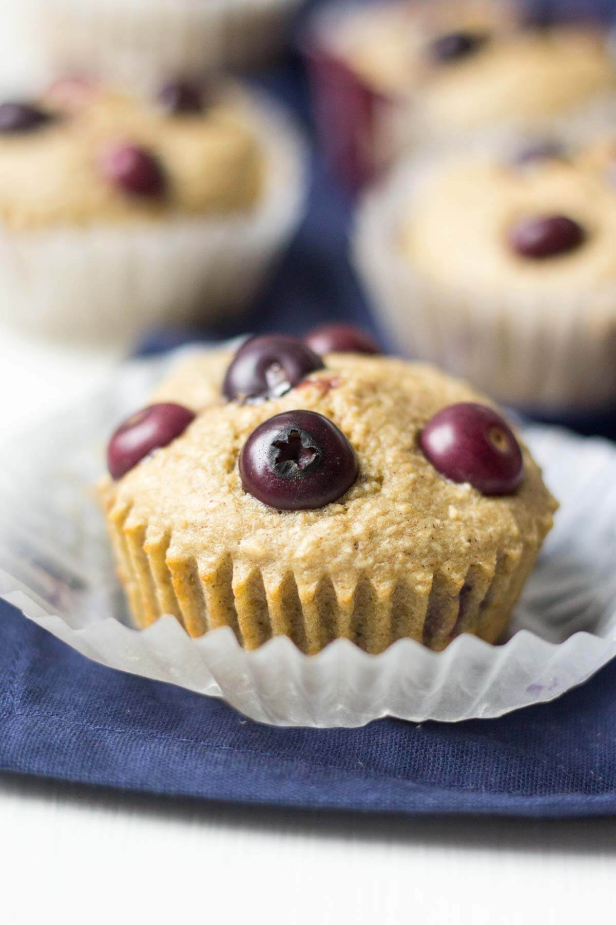 Easy to make and full of good-for-you ingredients, these triple berry blender muffins will show you just how easy and delicious breakfast can be. You will love the oats, blueberries, maple syrup and jam inside these easy muffins!